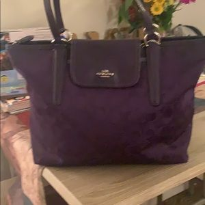 Signature purple medium sized Coach shoulder bag